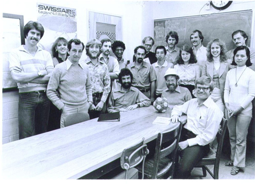 M.G. Rossmann's research group at Purdue University circa 1980 when the structure of SBMV was first established by X-ray diffraction methods. There were several protein projects besides the virus. Michael is wearing the hardhat that he used to build the SBMV model with the author who is to his right.